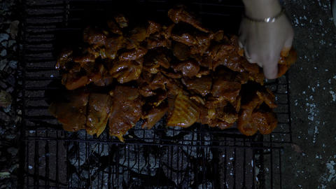 Meat in the marinade spread on the grill for frying Live Action