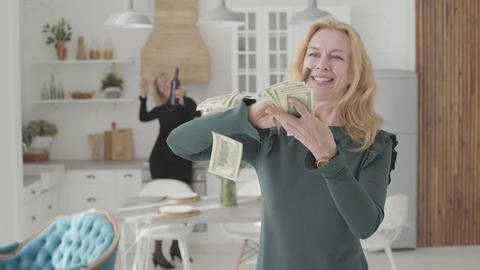 Rich mature Caucasian woman with a cigar scaterring money and smiling. Her Live Action