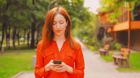active businesswoman using smartphone in city Footage