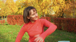 Sport woman dancing on choreography class in autumn park. Dancer woman training Footage