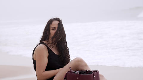 Young woman relaxes on the beach during her summer vacation Stock Video Footage