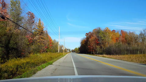 Rear View From Back of Car Pulling Over to Side of Rural Countryside Road During Day. Car Point of Live Action