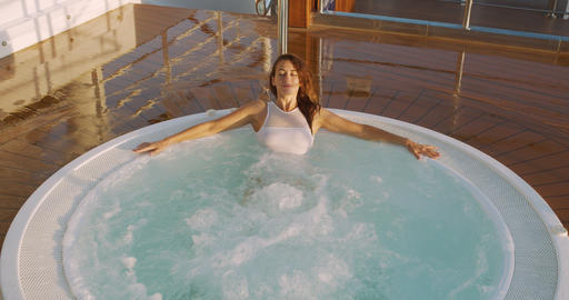 Young woman in bikini in hot tub. Concept chill out, relax, leisure time Footage