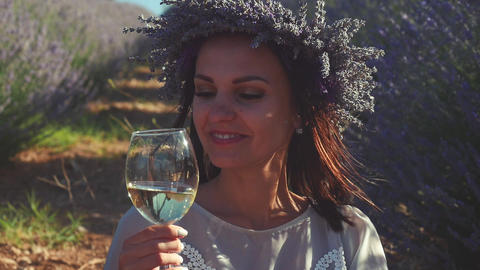 Young pretty woman tasting white wine outdoors Footage