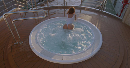 Woman relaxing in hot tub whirlpool jacuzzi outdoor at luxury resort Footage
