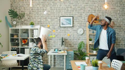 Playful businessmen throwing paper balls in basket having... Stock Video Footage