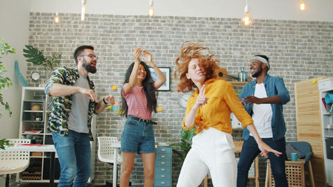 Redhead girl dancing at office party while colleagues clapping hands laughing Live Action