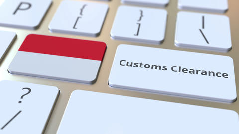 CUSTOMS CLEARANCE text and flag of Indonesia on the buttons on the computer Live Action