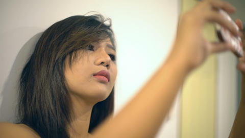 Young Asian woman making selfie photo on smartphone Footage