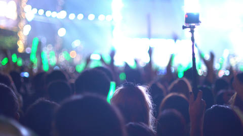 People making video with action camera at concert Footage