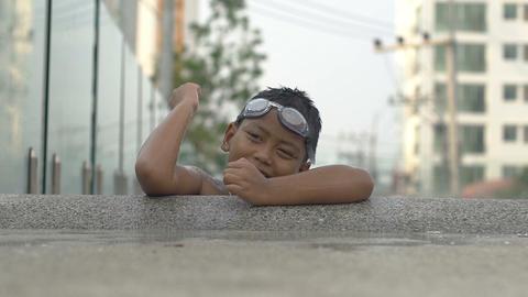Little boy on swimming pool edge slowmotion Footage