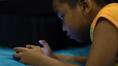 Little boy playing on smartphone Footage