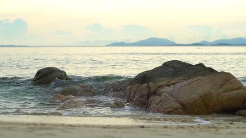 Sea waves crashing on rocks at beach slow motion Footage