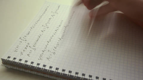 Handwriting math formulas in exercise book closeup time lapse Live-Action