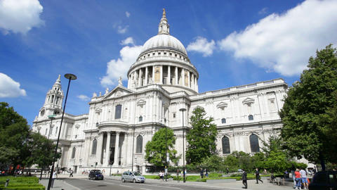 Time lapse of St. Paul's Cathedral in London with red buses passing, editorial Footage