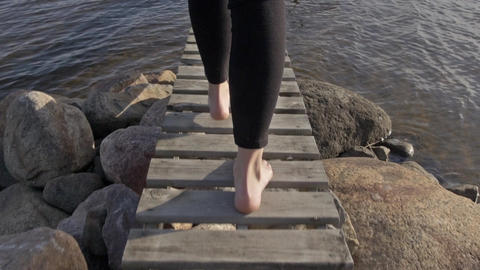 Young Woman Walking Out on Jetty in Slow Motion, Camera Following - Natural Look Footage
