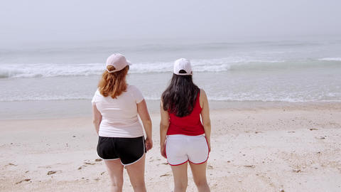 Summer Sun and Fun at the beach - girls relax and have a great time at the Footage