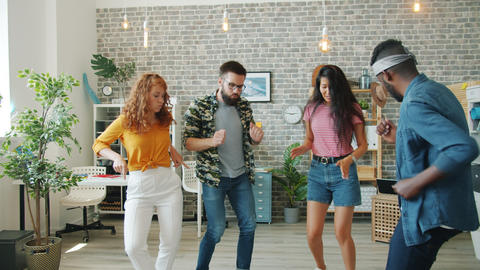 Slow motion of creative girls and guys dancing in office having fun together Footage