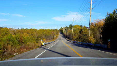 Rear View From Back of Car Driving Rural Countryside Road During Day. Car Point of View POV Behind Live Action