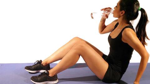Attractive Fitness Woman Drinking Water After Workout Live Action