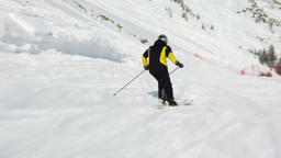 Young adult recreational skier enjoys idyllic perfect weather in cold winter Footage