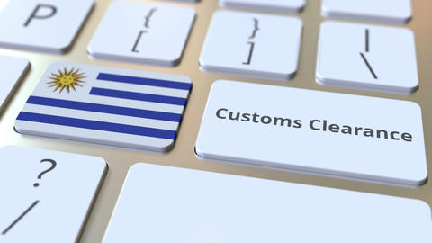 CUSTOMS CLEARANCE text and flag of Uruguay on the buttons on the computer Live Action