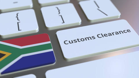 CUSTOMS CLEARANCE text and flag of South Africa on the computer keyboard. Import Live Action