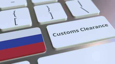 CUSTOMS CLEARANCE text and flag of Russia on the computer keyboard. Import or Live Action