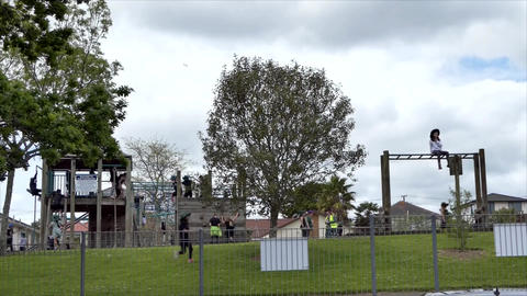 Auckland, New Zealand, 01.10.19, school children playing at the kids play ground Live Action
