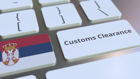 CUSTOMS CLEARANCE text and flag of Serbia on the computer keyboard. Import or Live Action