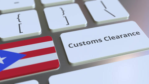 CUSTOMS CLEARANCE text and flag of Puerto Rico on the computer keyboard. Import Live Action