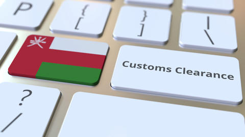 CUSTOMS CLEARANCE text and flag of Oman on the computer keyboard. Import or Live Action