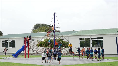 Auckland, New Zealand, 01.10.19, school children playing at the kids play ground Footage