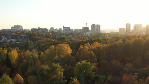 Beautiful aerial view of autumn city park and Botanic garden with cable car Footage
