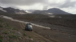 Japanese SUV driving on mountain road in direction of travel destinations Footage