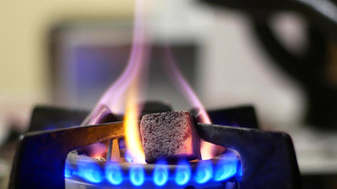 Coal is heated on a gas stove Stock Video Footage