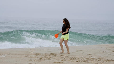 Beautiful girl has fun on the beach at the oceanfront - summer holiday Live Action