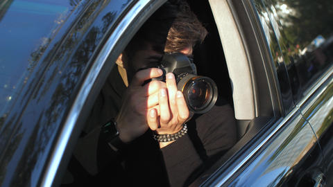 Man taking picture from the car Live Action
