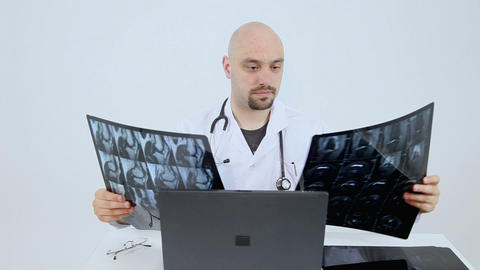 Doctor looking at xrays Live Action