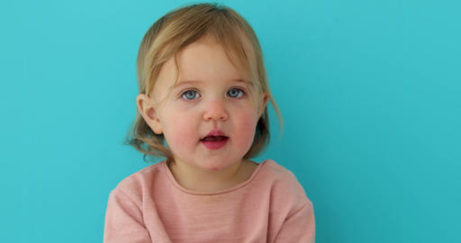 Baby portrait of child isolated on blue background Footage