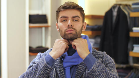 Man trying on clothes in store Footage