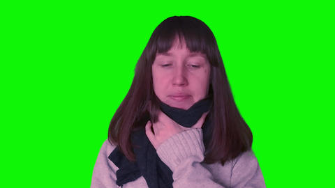 Young millennial girl caught cold on green screen Footage