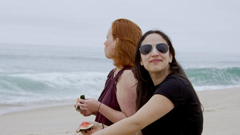 Relaxing at the beach while eating a water melon Footage