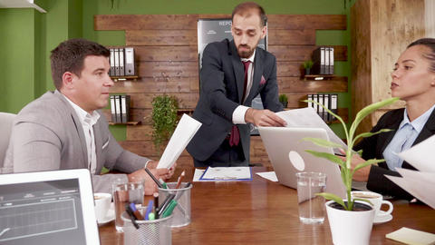 Businessman presents new project to colleagues in the conference room Footage