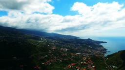Flight ocean mountain village city coast. Portugal Madeira Funchal 4k video Footage