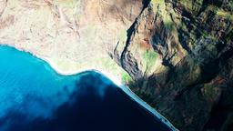 Flight aerial over rugged coastline surf water ocean sea surface 4k video Footage