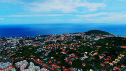 Portugal Madeira Funchal 4k aerial video. Flight over city houses ocean coast Footage