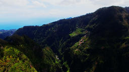 Portugal Madeira 4k aerial video. Mountain ravine village hills, sea ocean coast Footage