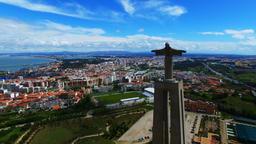 Flight over Christ the King statue, Portugal Almada near Lisbon City 4k video Footage