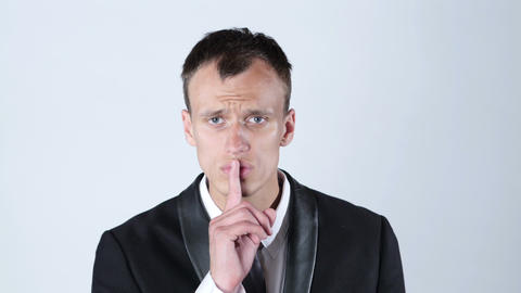 Businessman silent quiet gesture with finger Footage